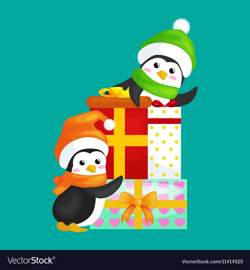 Two happy cute Christmas penguin in hat and scarf