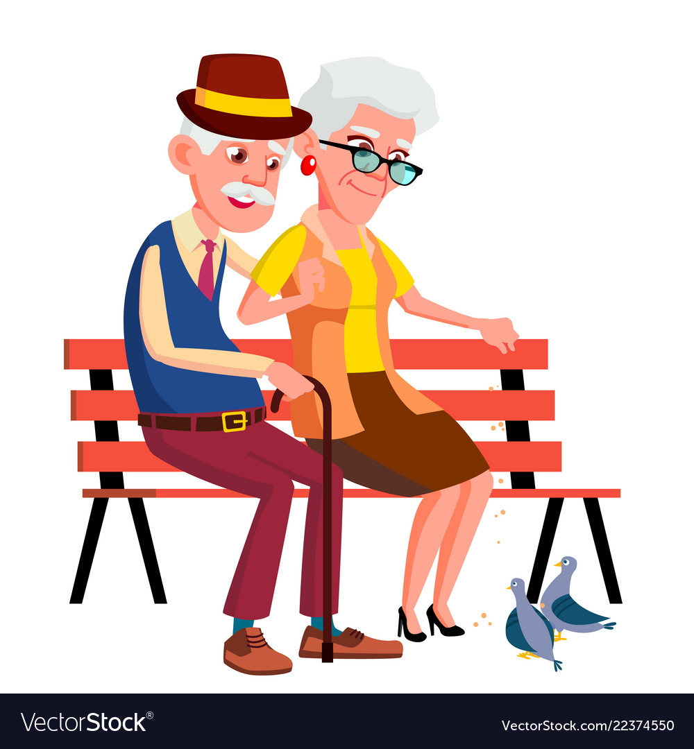Elderly couple sitting on bench in summer autumn