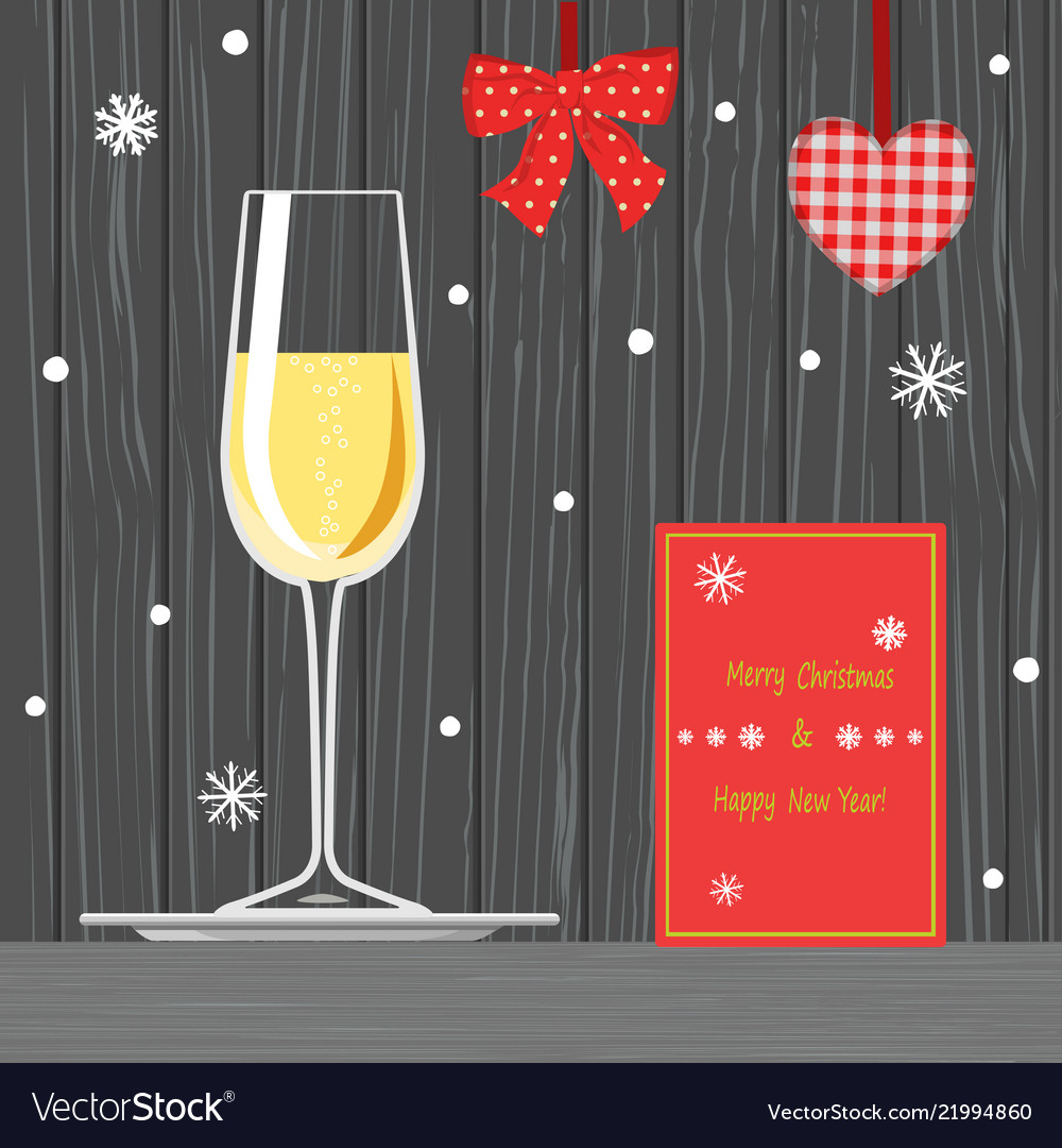 Glass of champagne on tray and christmas card