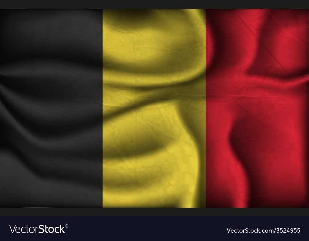 Crumpled flag of Belgium on a light background