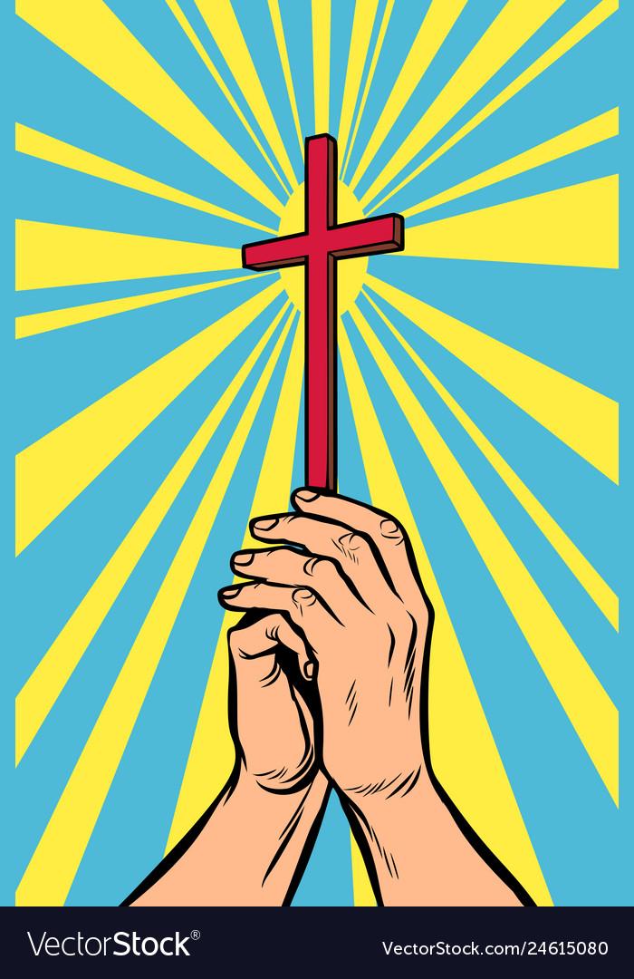 Christian cross in light hands the