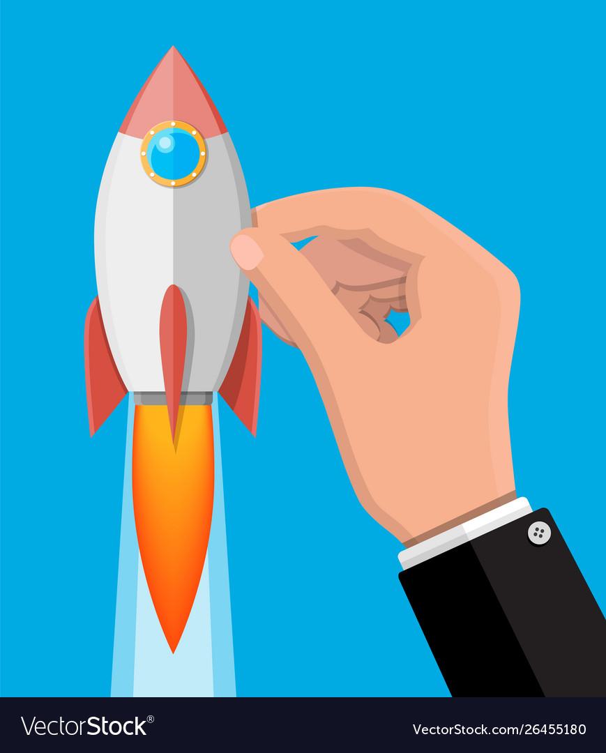 Cartoon rocket in businessman hand