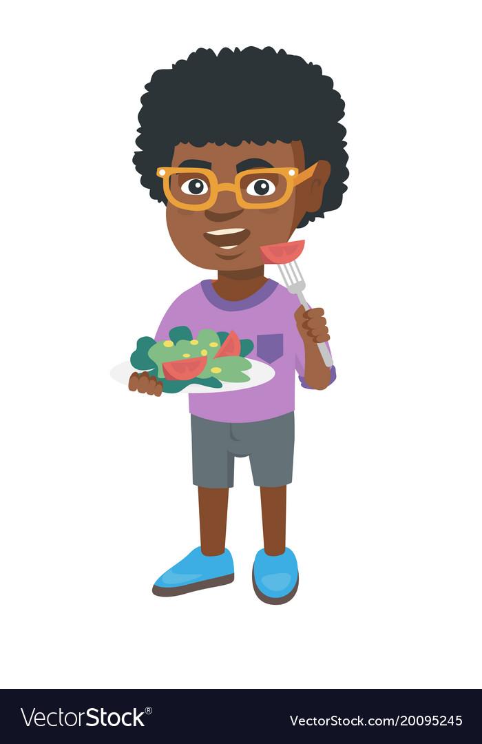 Little african-american boy eating vegetable salad