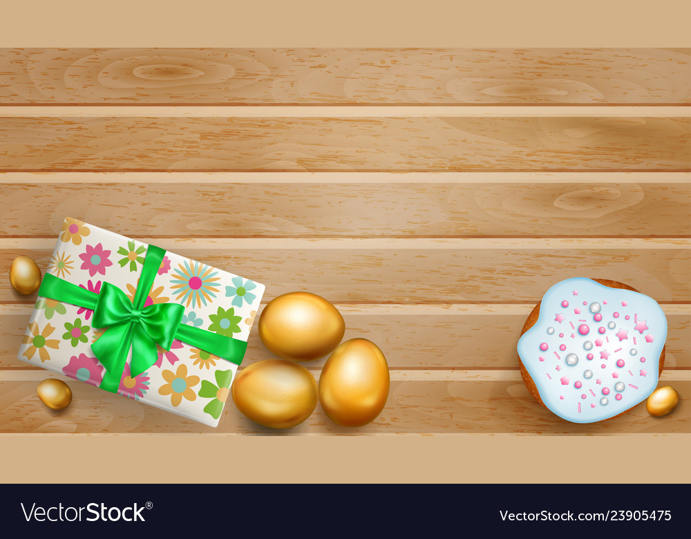 Golden easter eggs cake and gift box on wooden