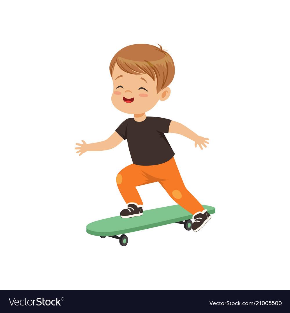 Cute little boy riding skateboard kids physical