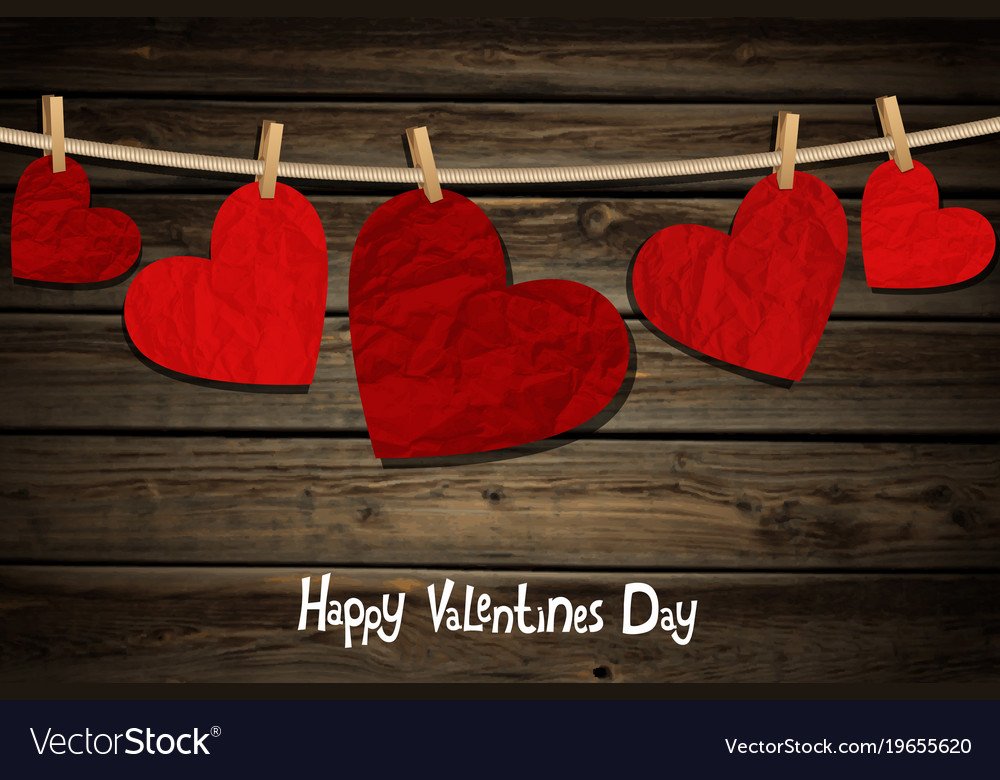Hearts on a wood background vector image