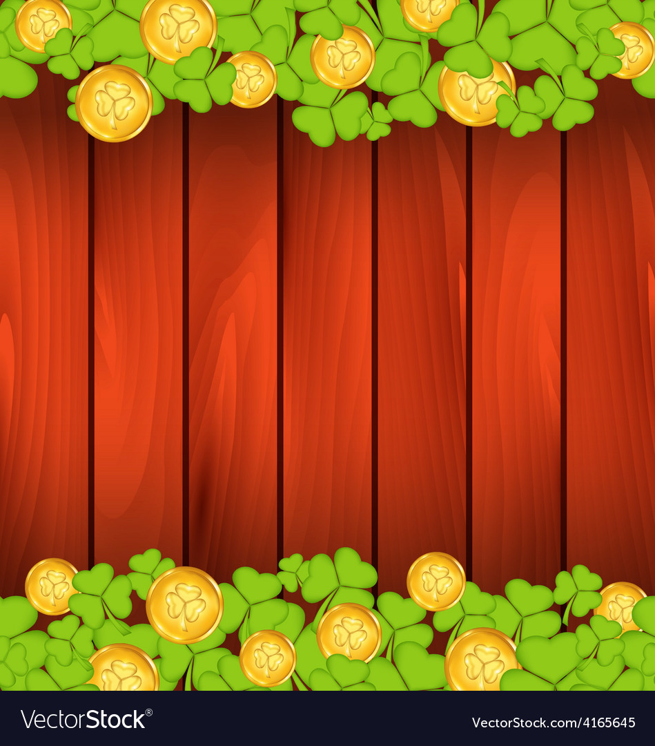 Clovers and golden coins on brown wooden