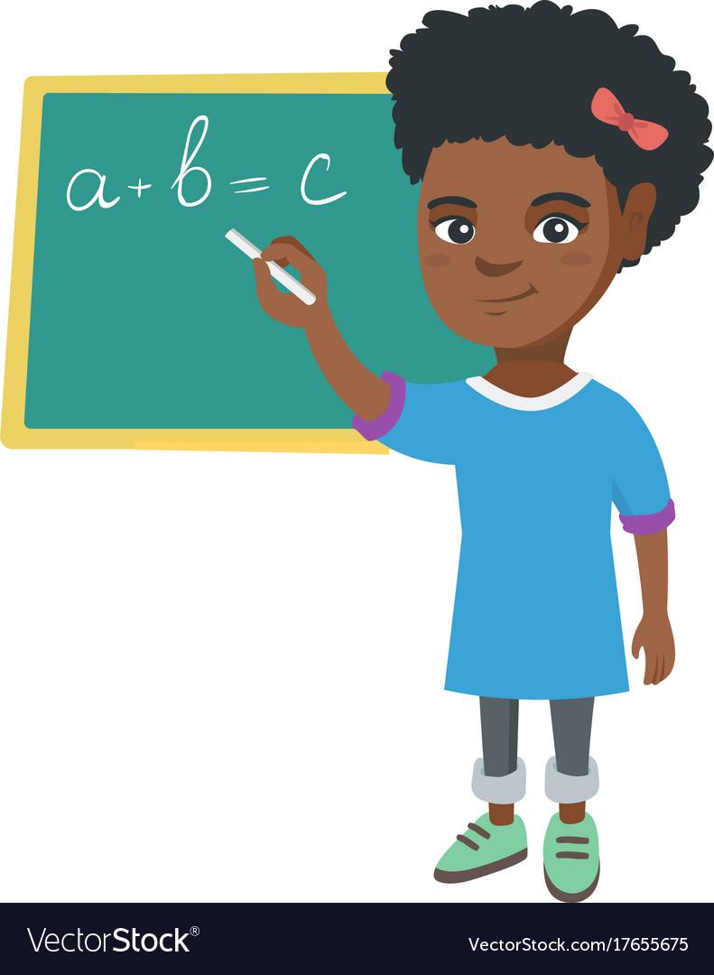 African schoolgirl writing on the blackboard