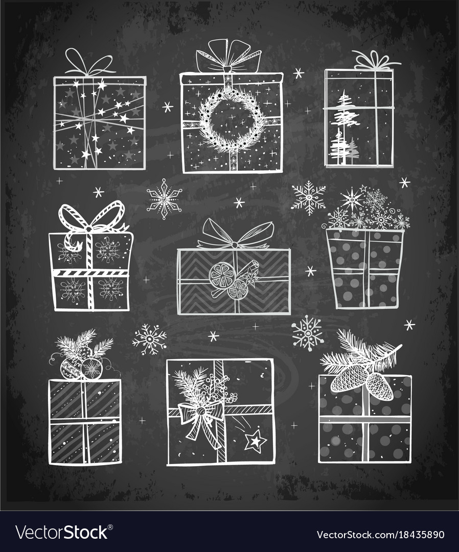 Christmas gift boxes on blackboard background