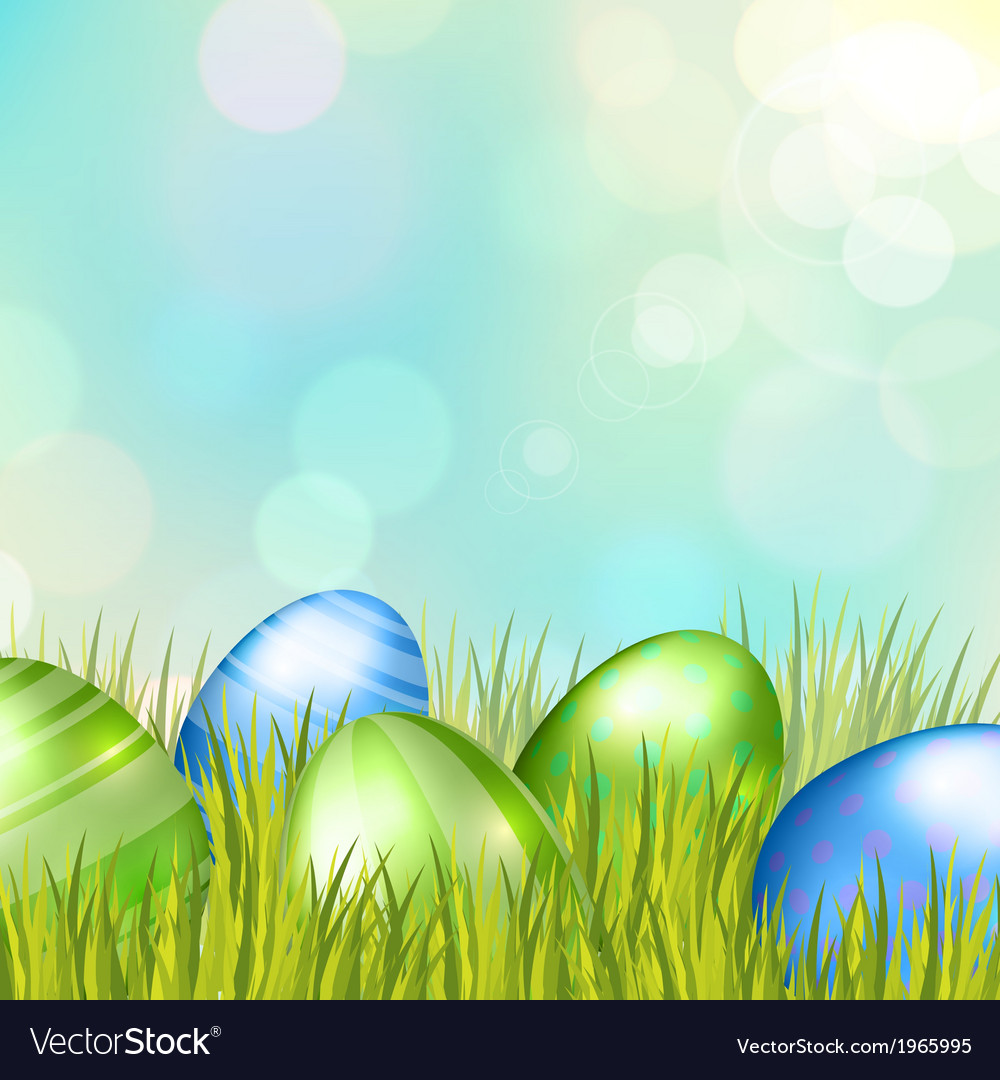 Easter bokeh background with eggs on meadow