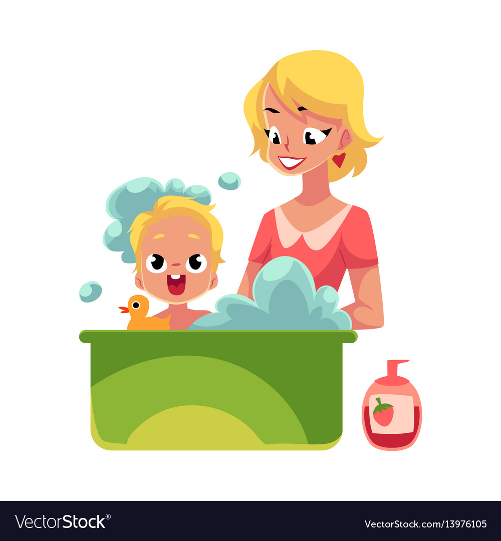 Young mother washing her baby in bathtub full of