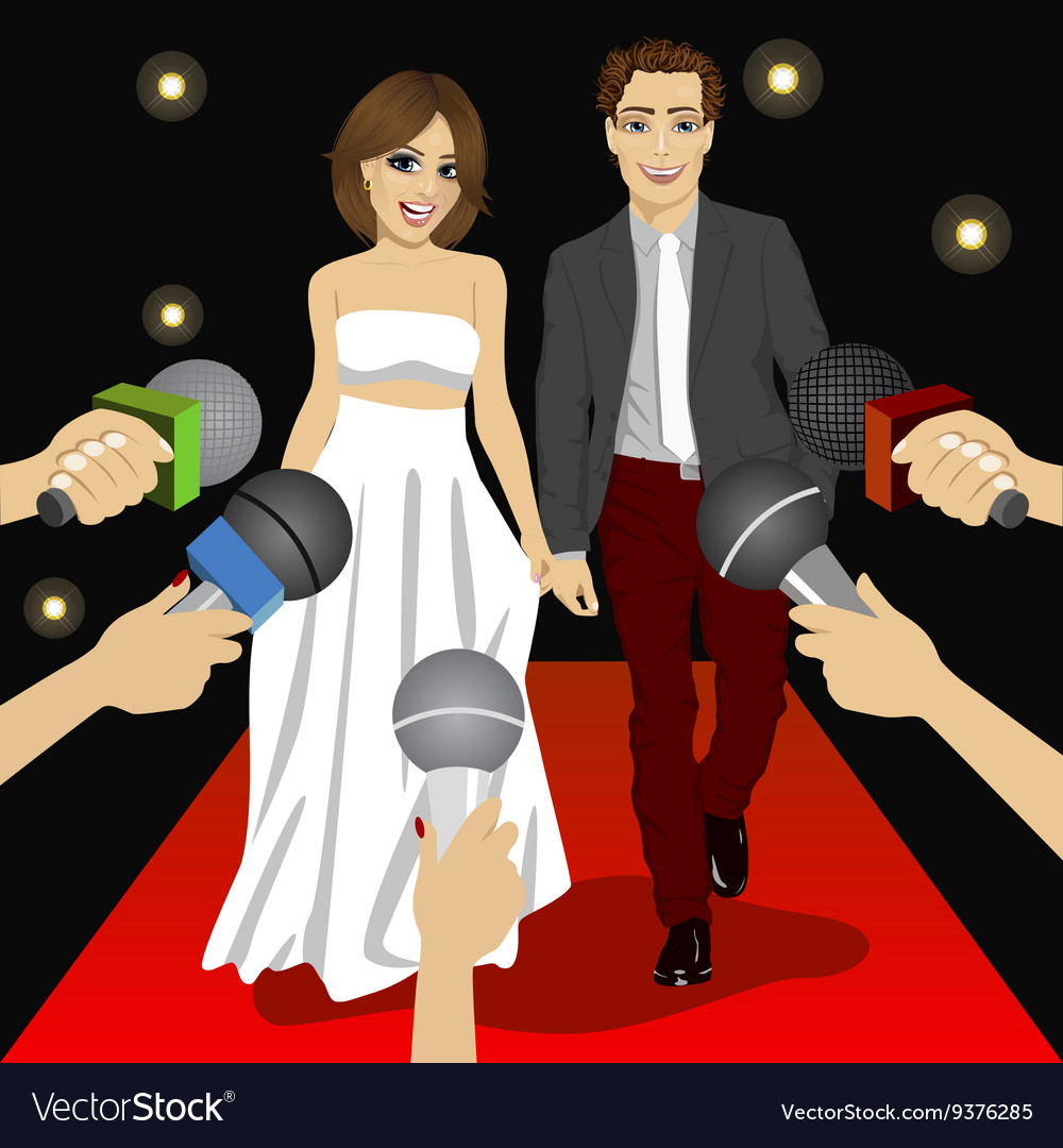 Fashionable couple on a red carpet event