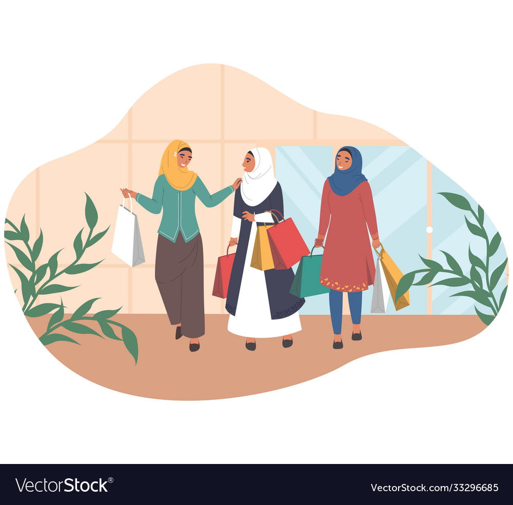 Happy arab women walking with shopping bags