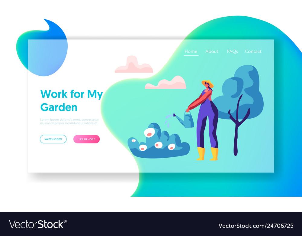 Woman gardener in hat watering bush in garden