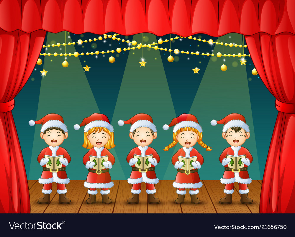 Group of children singing christmas carols on the