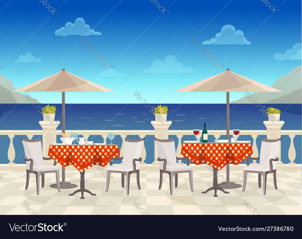Cafe with tables under umbrellas with sea views on