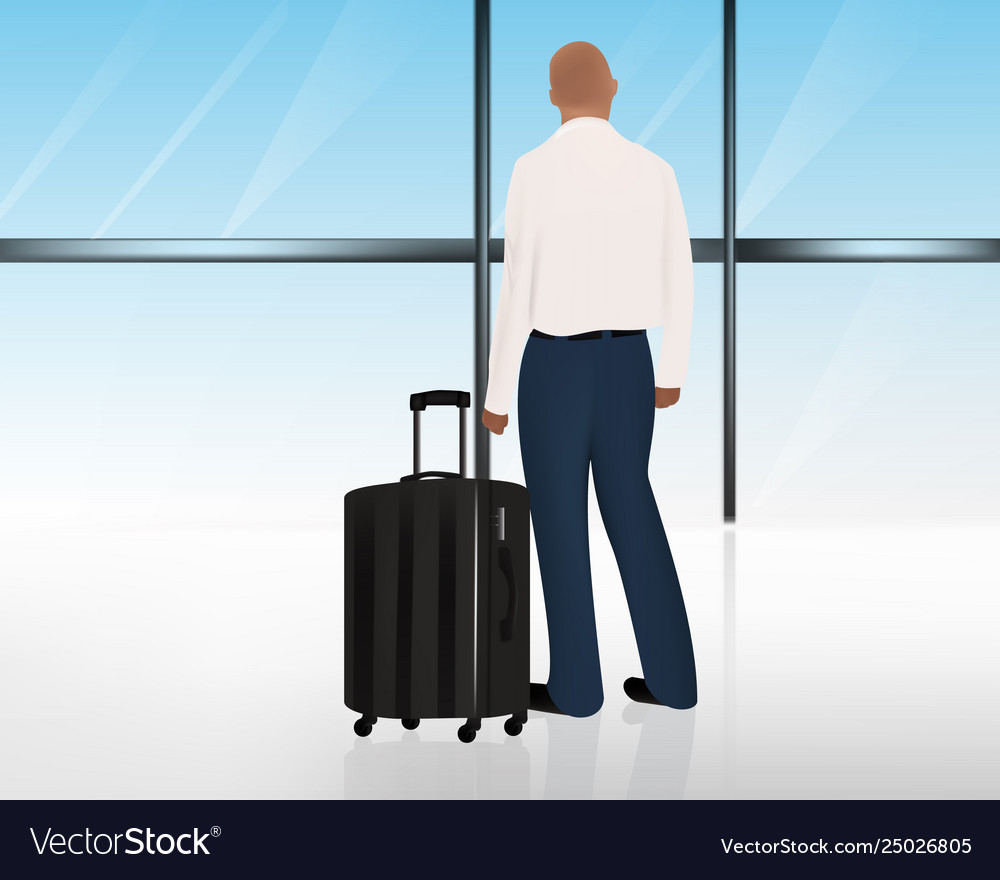 Man standing besides his luggage or suitcase at