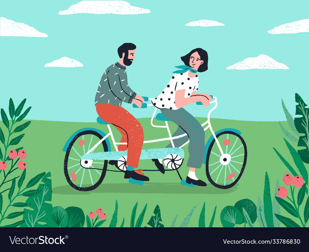 Cute couple riding on tandem bike at nature