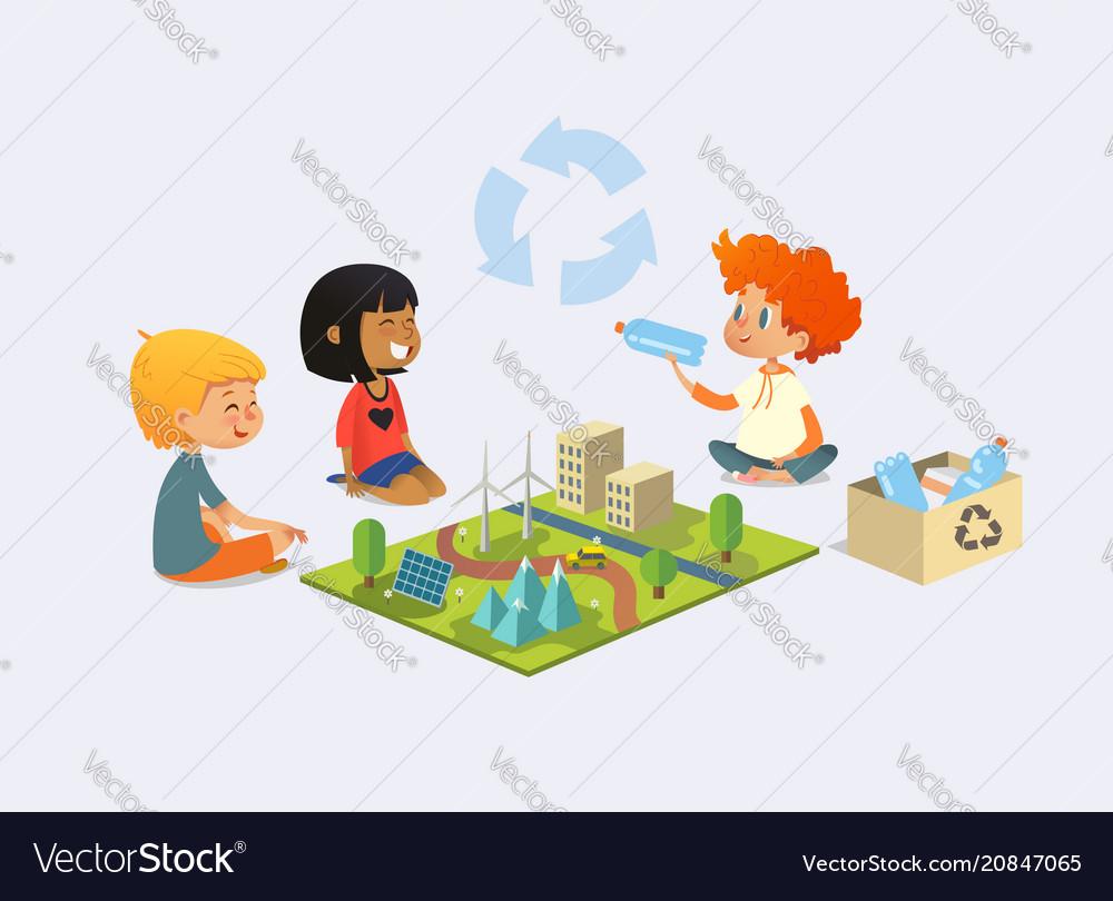 Happy kids sit on floor in circle around toy model