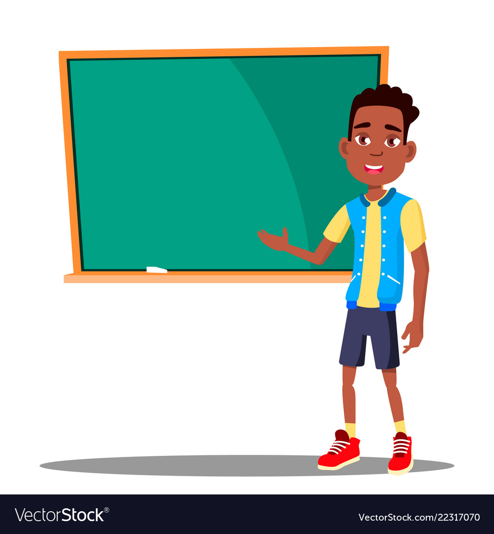 Little boy answers at the blackboard in the