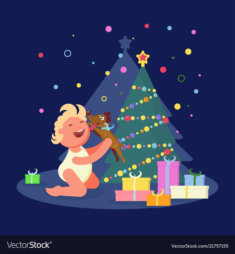 Baby rejoices near xmas tree