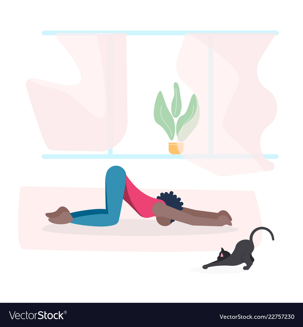 Young woman and her cat do yoga together