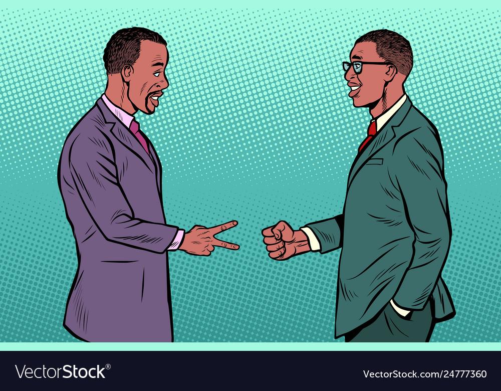 African businessmen game rock paper scissors