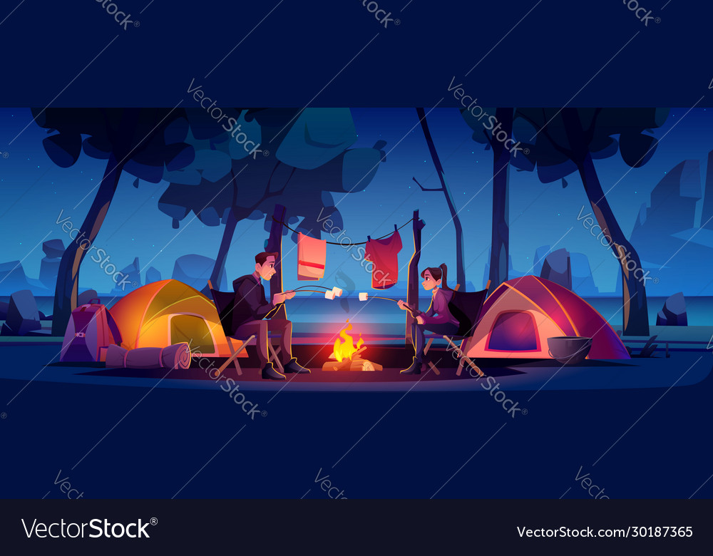 Couple in camp with tent and campfire at night