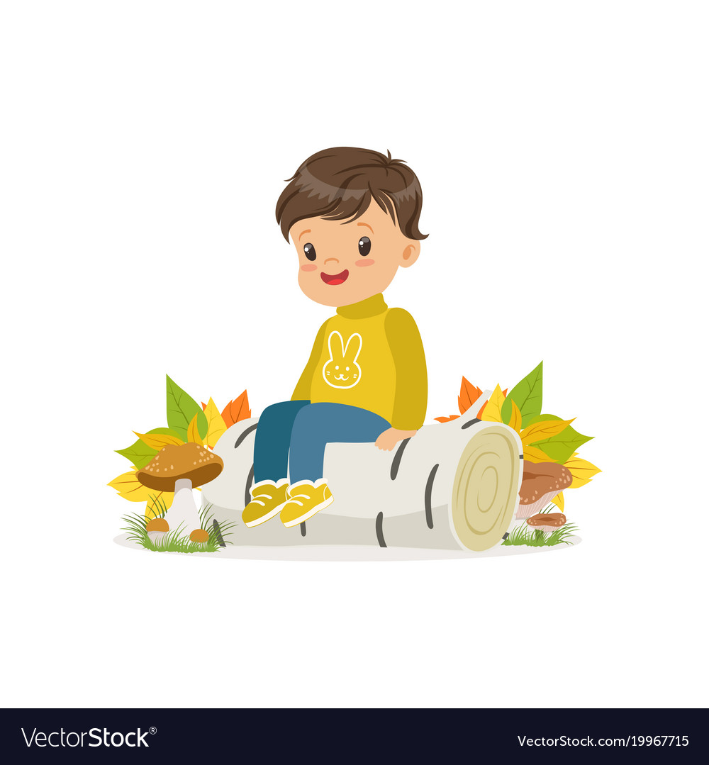 Cute little boy in warm clothing sitting on the