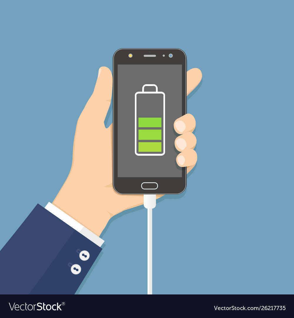 Human hand holding mobile phone with charger