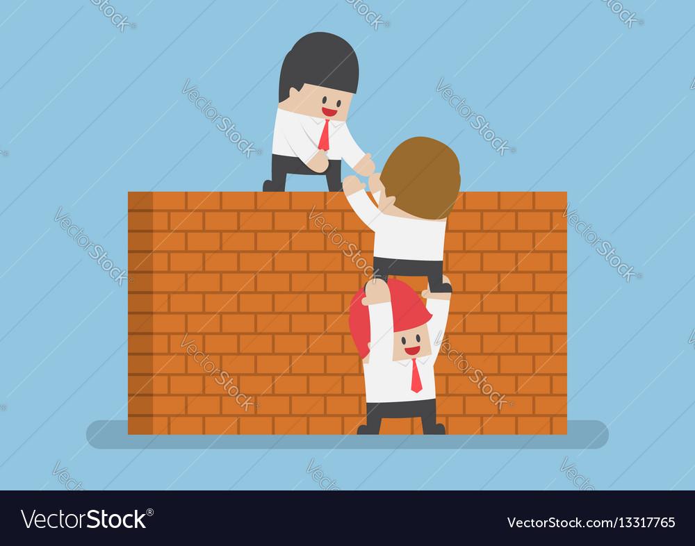 Businessman help his friend to cross the brick