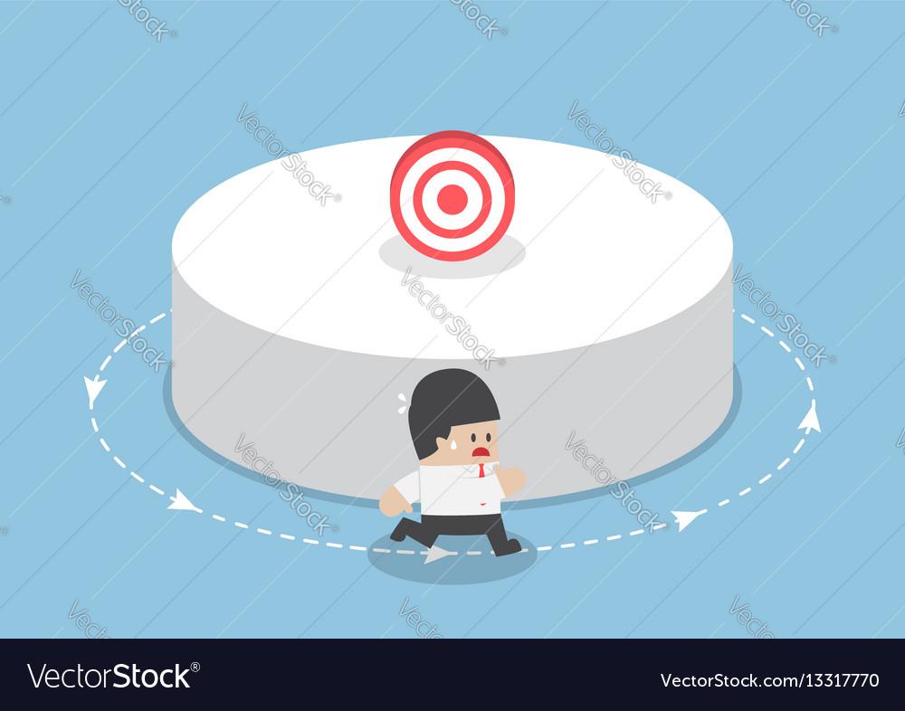 Businessman running around the target
