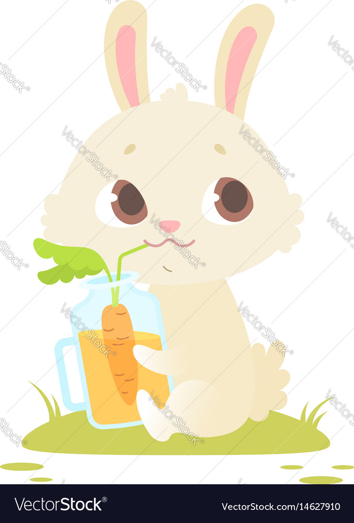 Cute baby bunny sitting on a green grass