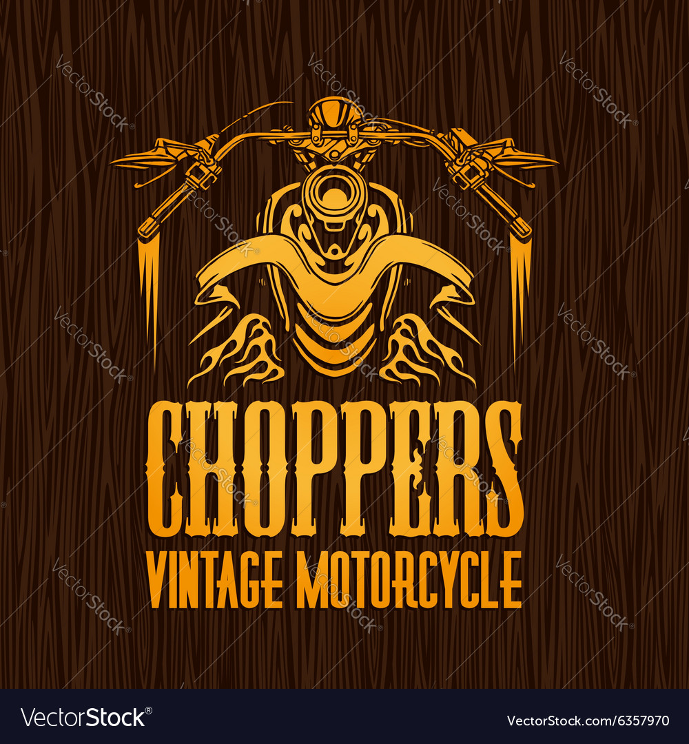 Gold vintage bikers badge on the wooden texture
