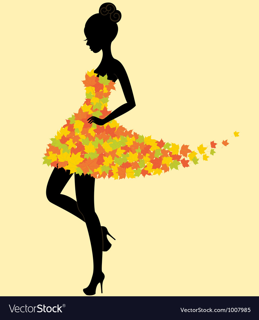 Dancer girl in dress of autumn leaves