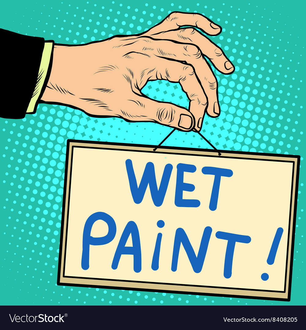 Hand holding a sign wet paint