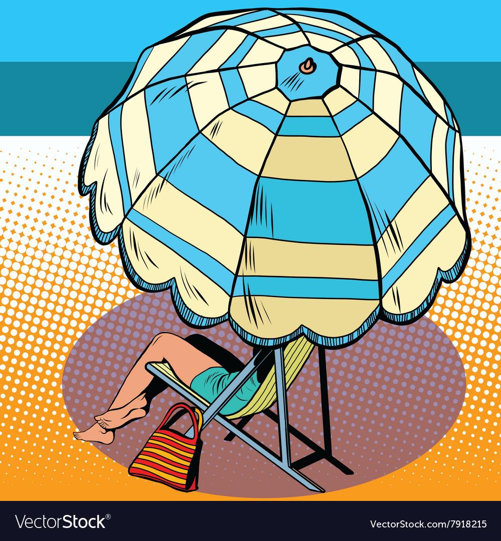 Girl under a beach umbrella vacation at sea
