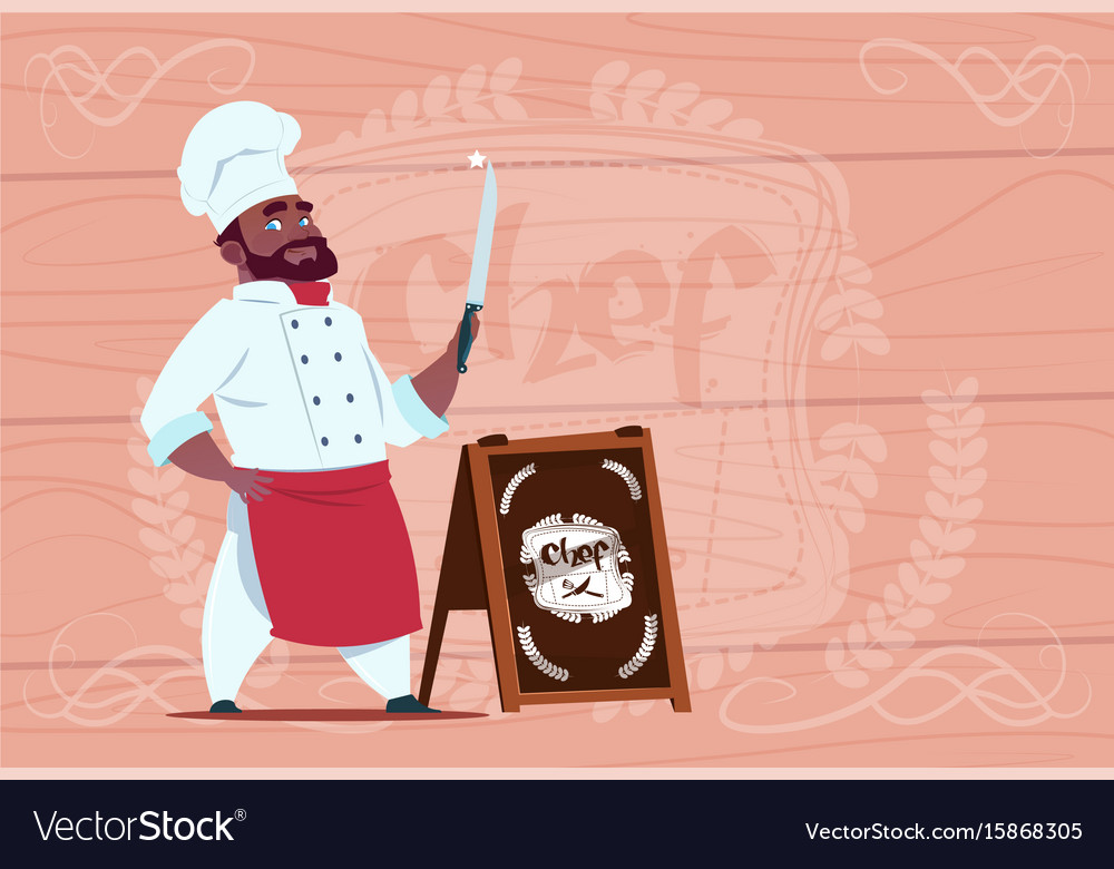 African american chef cook holding knife smiling