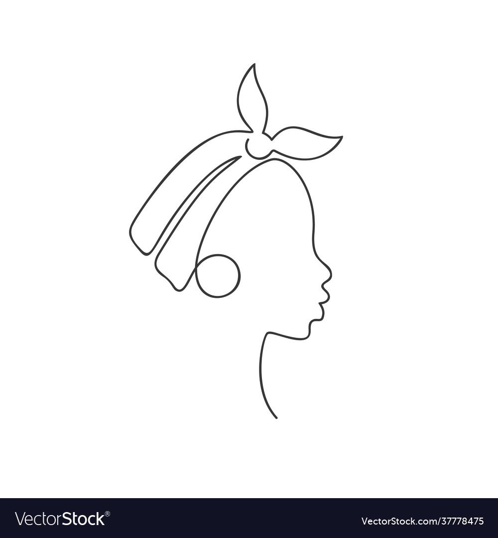 African girl in profile in headband and big