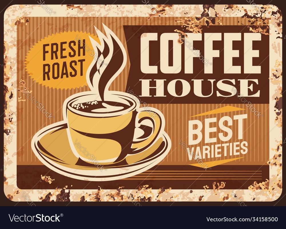 Steaming coffee cup rusty metal plate