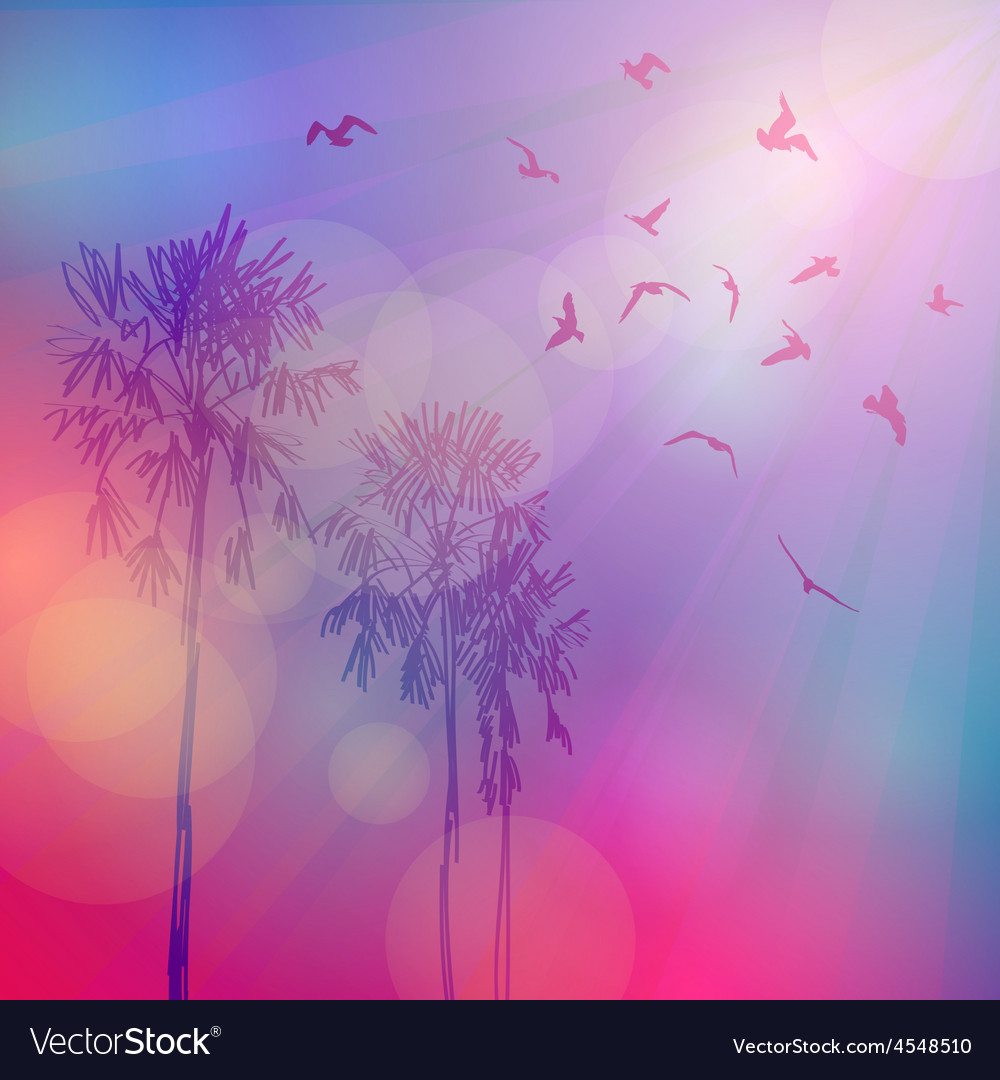 Silhouette of palm trees and birds sky pink