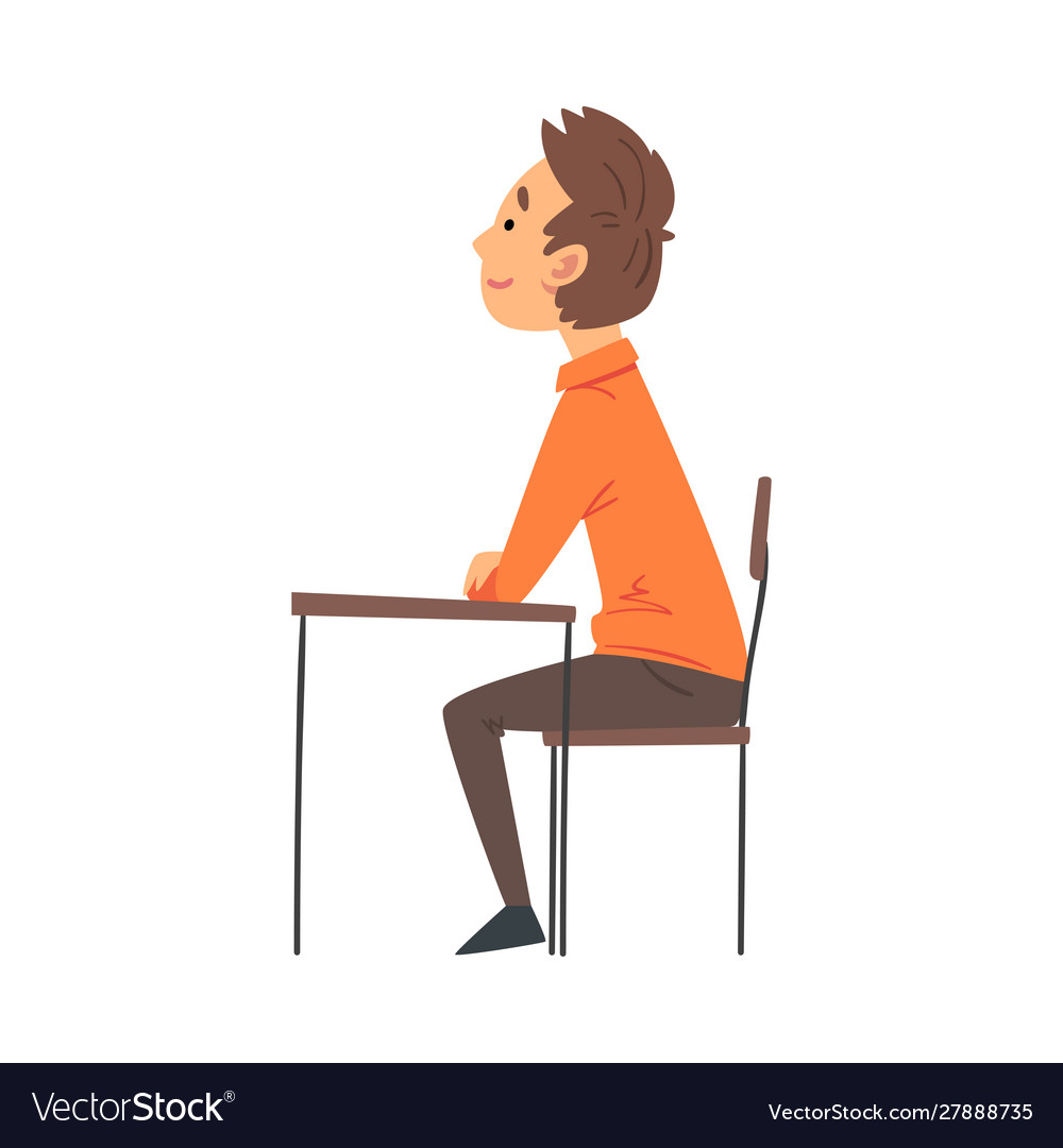 Boy student sitting at desk in classroom and