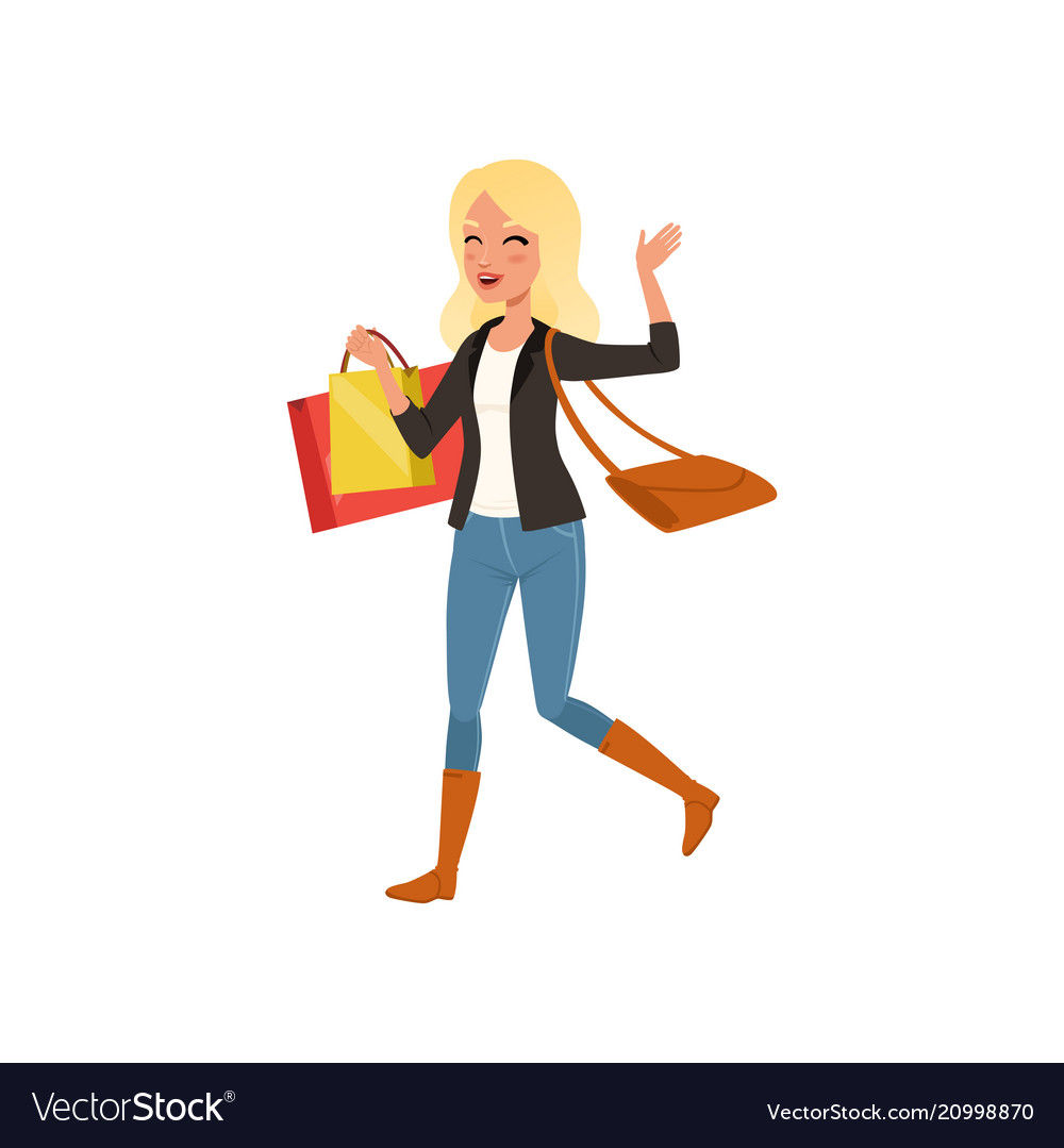 Happy blond woman walking with shopping bags from