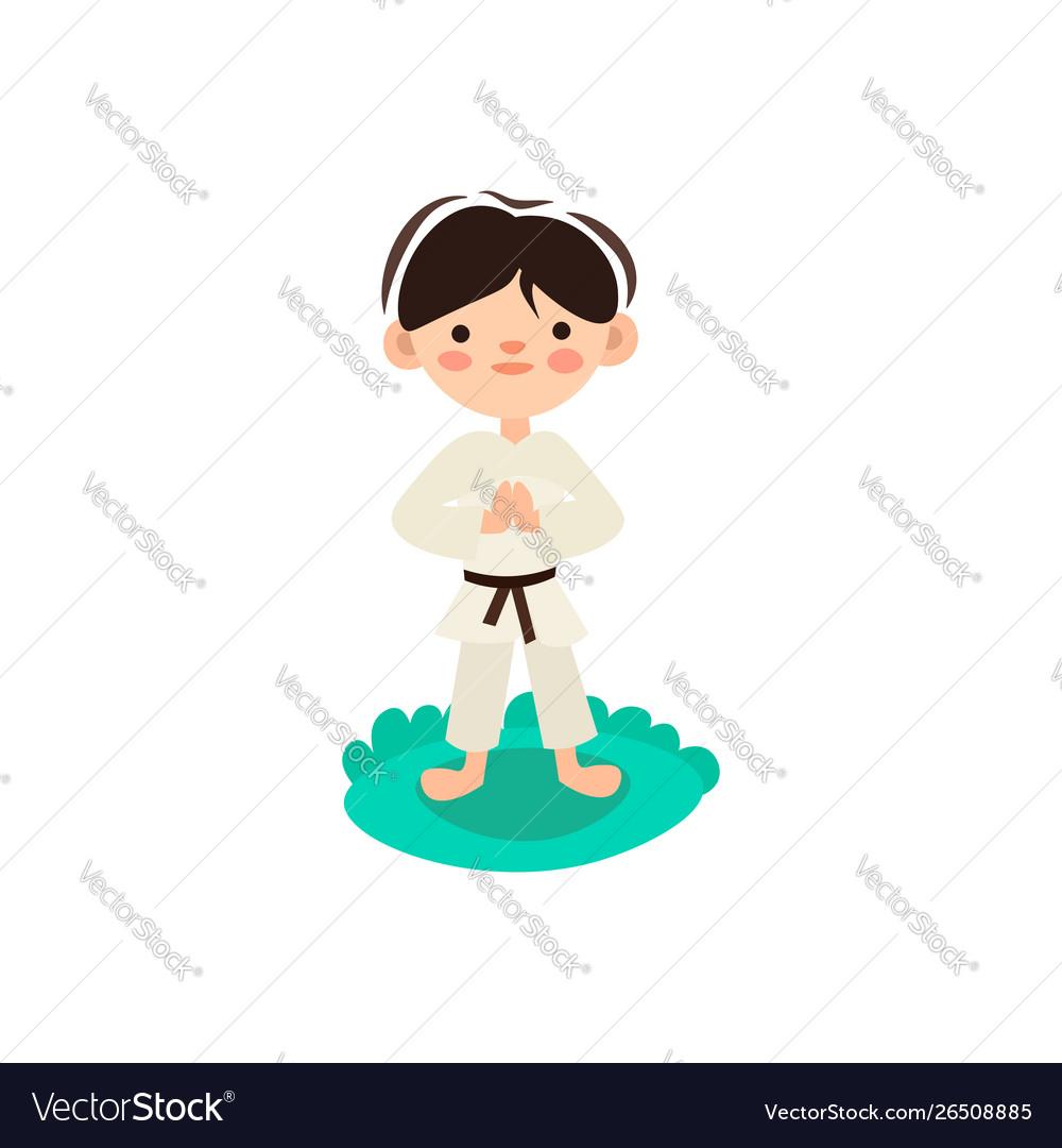 Little kid child preparing for karate training