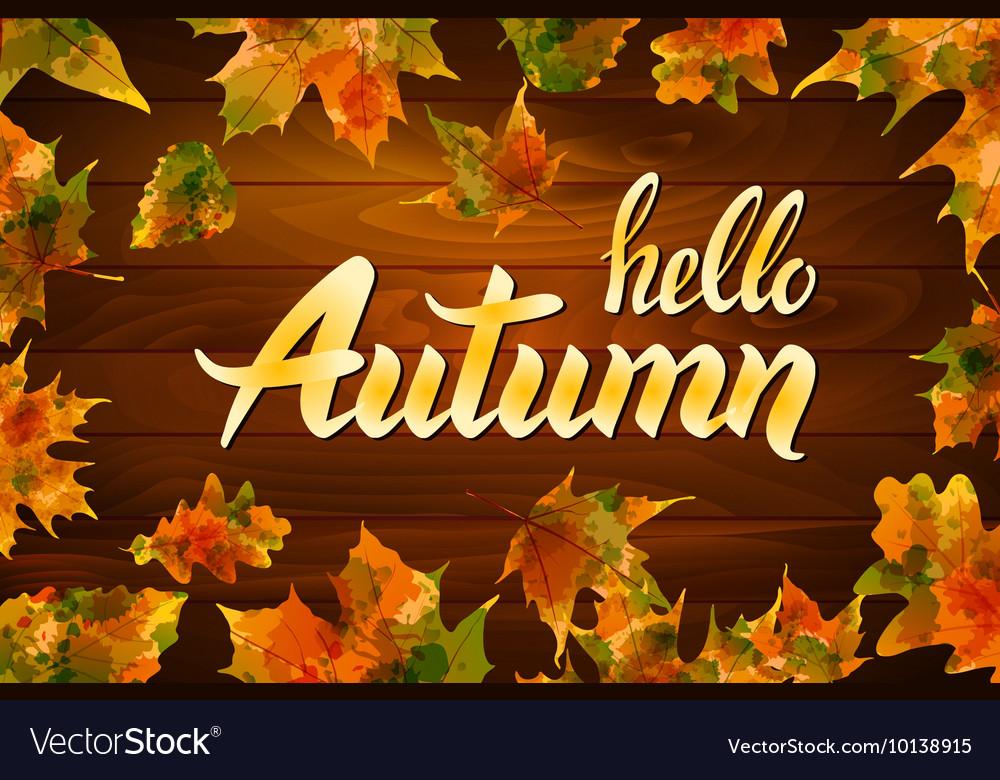 Hello autumn text on wooden background orange leaf