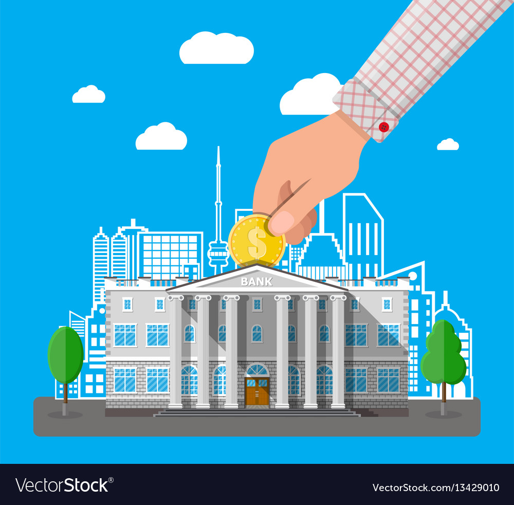 Hand putting coin into bank building