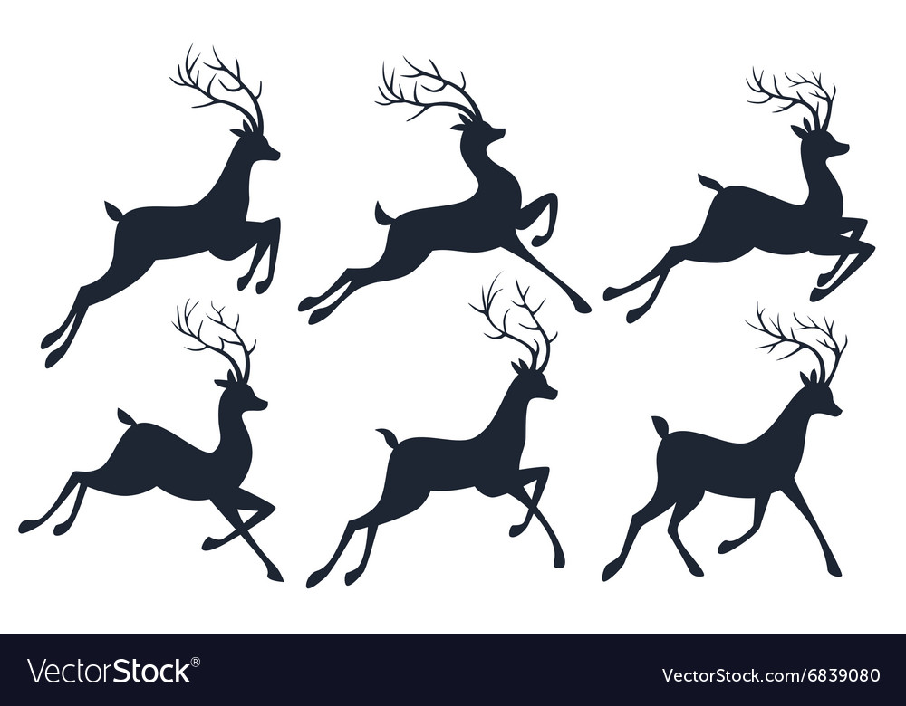 Christmas Reindeer Silhouette.Christmas Reindeer Silhouettes Isolated On White