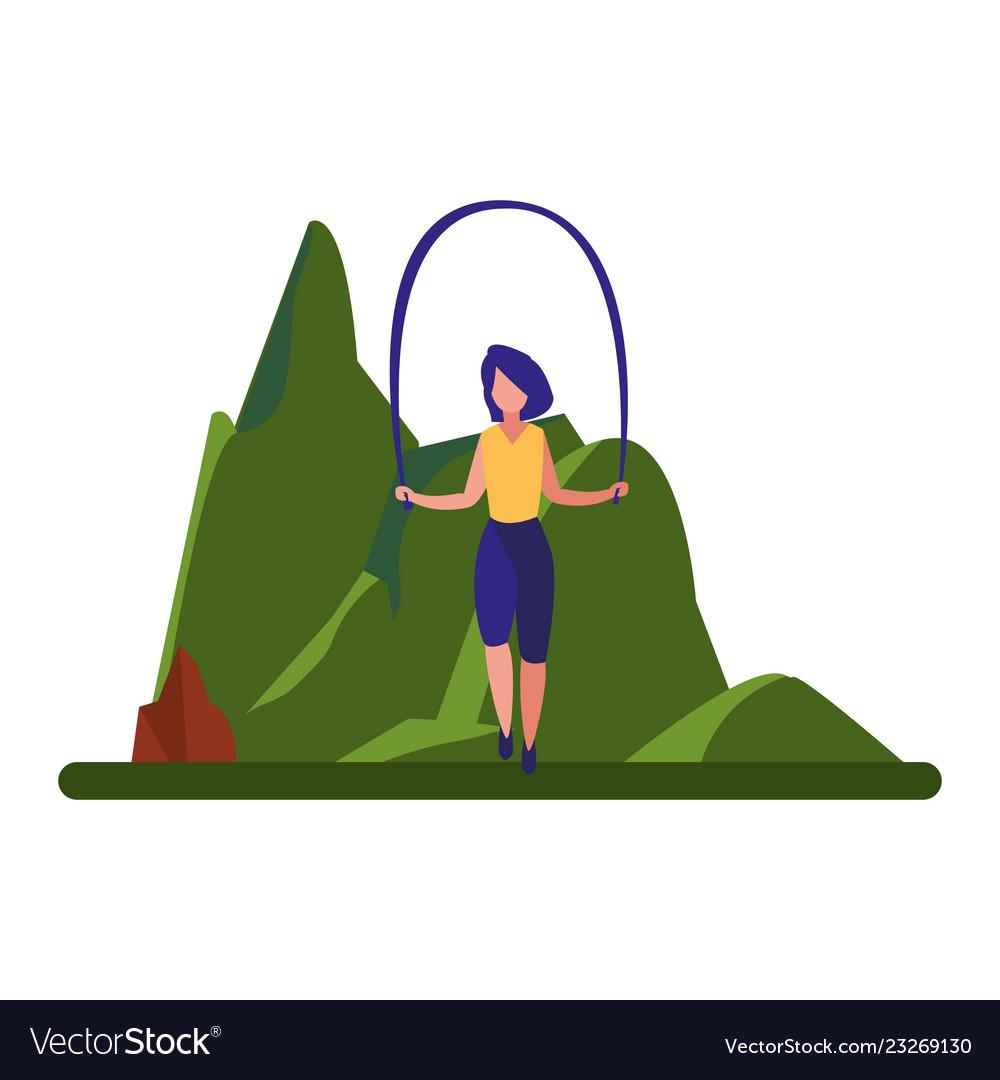 Woman jumping rope near tree
