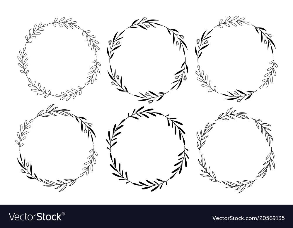 Set of hand drawn round floral wreaths