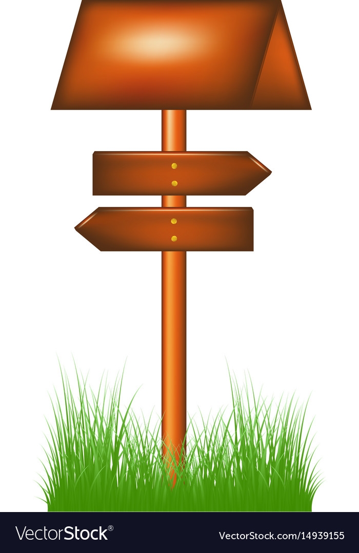 Wooden direction sign standing in the grass